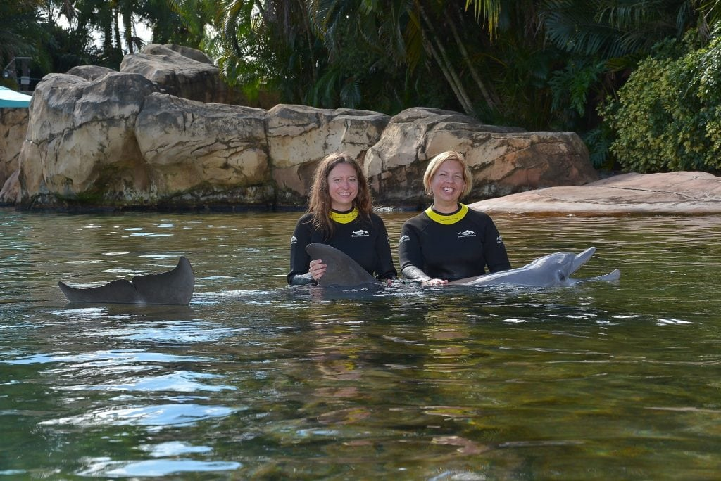 two women with dolphin Discovery Cove Orlando Florida