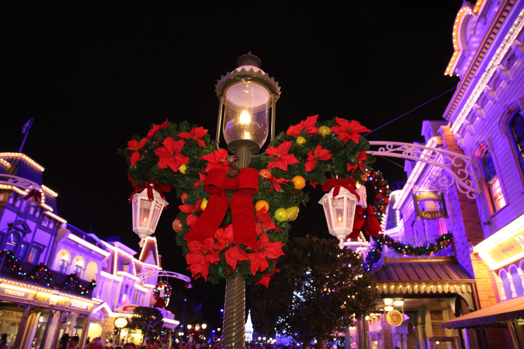 Mickey Mouse Head Shaped Christmas Wreath on Light Post Mickey's Very Merry Christmas Party Magic Kingdom