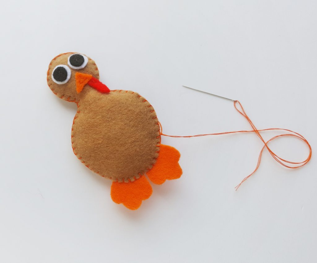sewing felt pieces for turkey craft