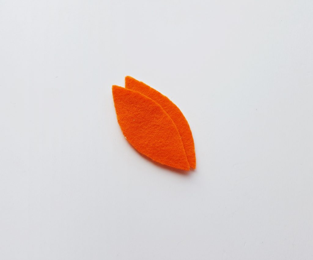 two leaves cut out of orange felt