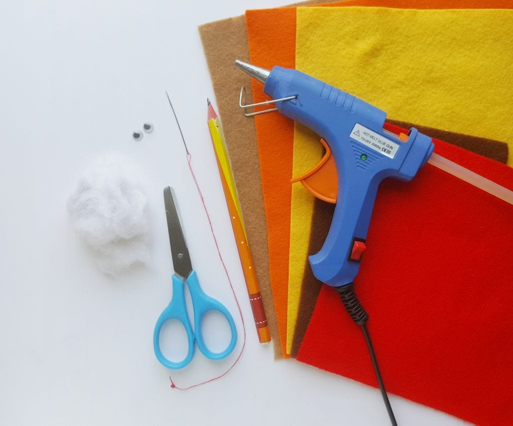 hot glue gun, felt pieces, cotton stuffing, scissors
