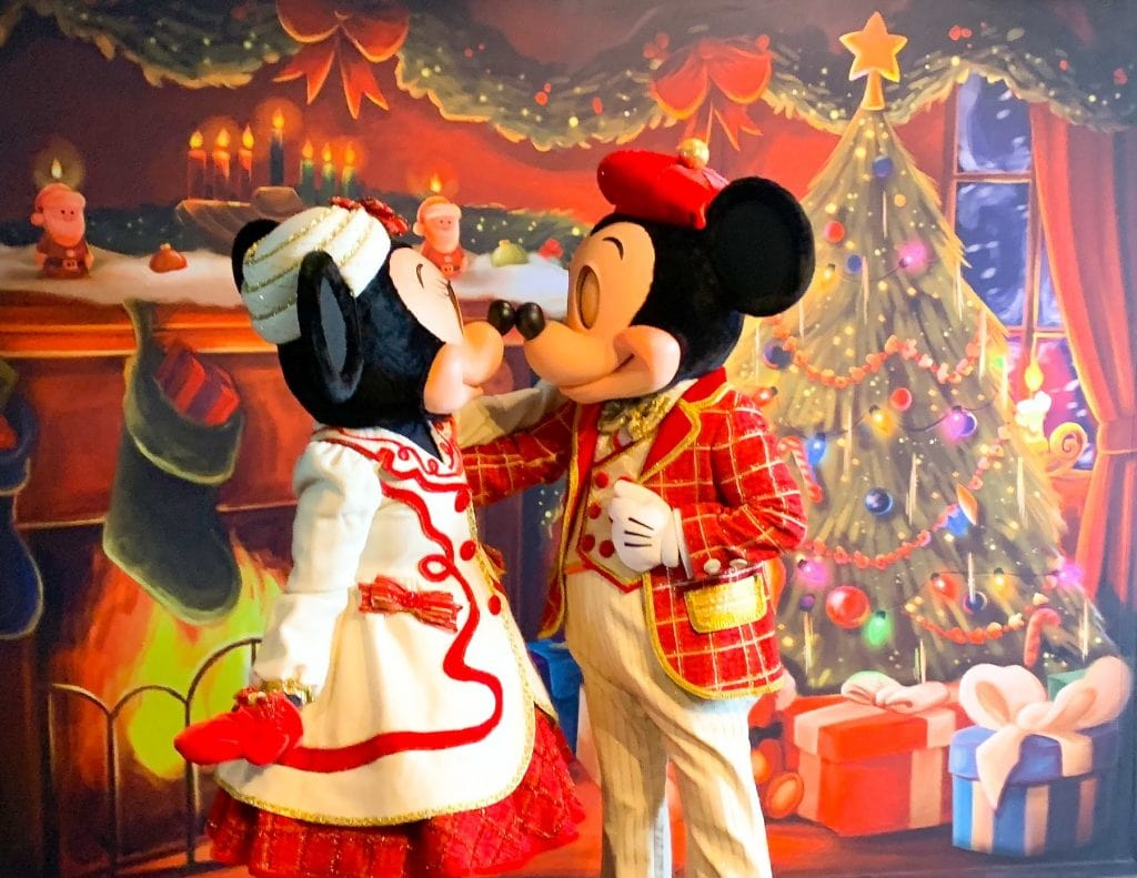 Mickey and Minnie Kissing in front of Christmas Tree