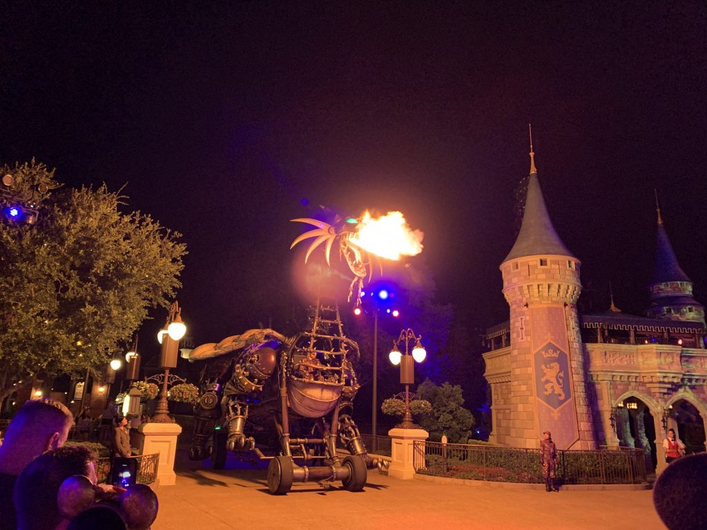 maleficent float breathing fire at night magic kingdom event