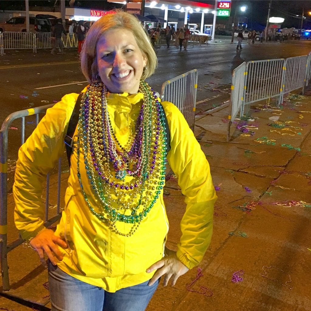 Kim wearing Mardi Gras beads Lake Charles Louisiana Parade