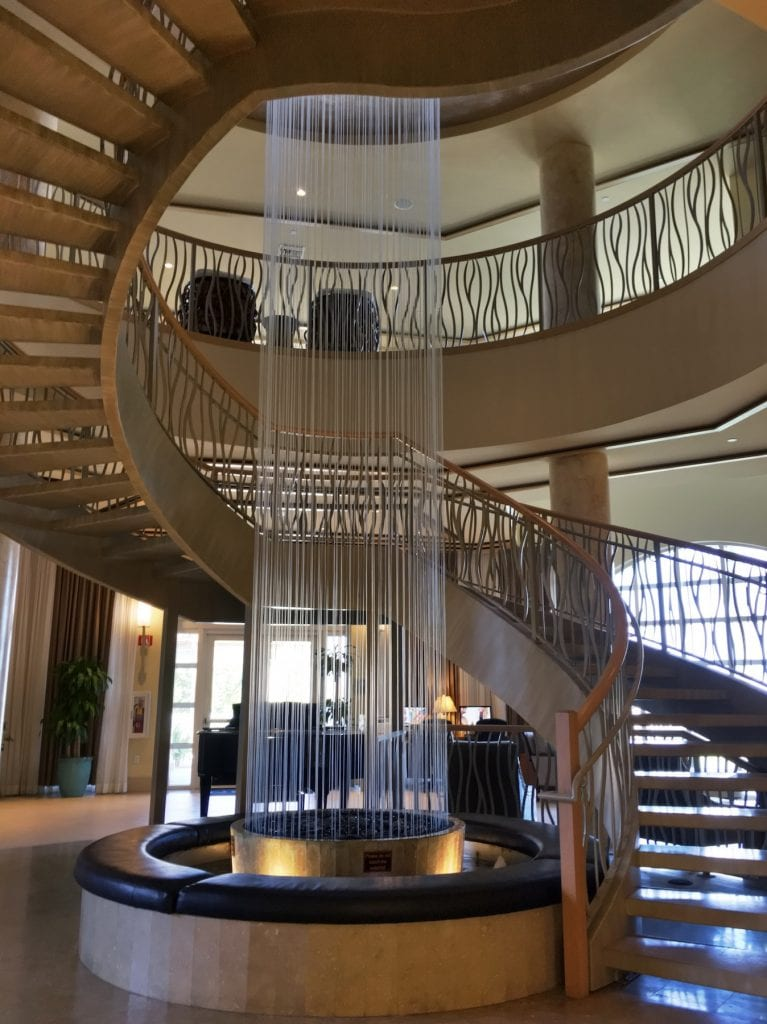 spiral staircase with vertical water feature in Westin cape coral lobby