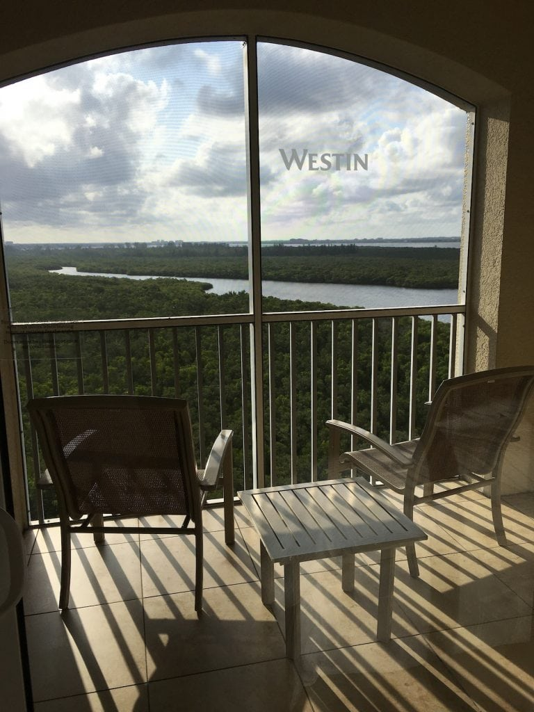 two chairs on private patio screened in overlooking river Westin Cape Coral fl