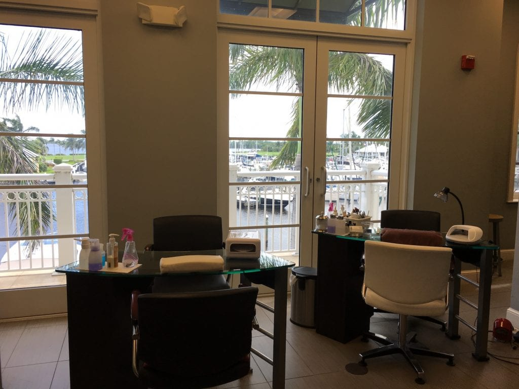 nail salon desks with large windows behind overlooking marina Westin