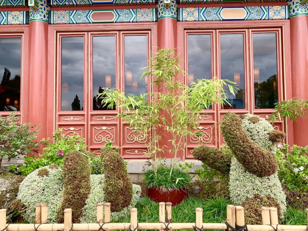 panda bear topiaries in front of Chinese wall Epcot flower and garden festival