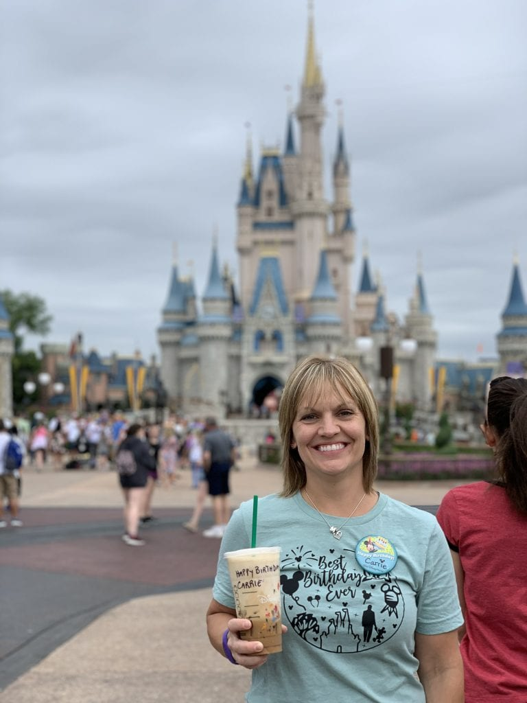 girl celebrating birthday at magic kingdom in front of castle