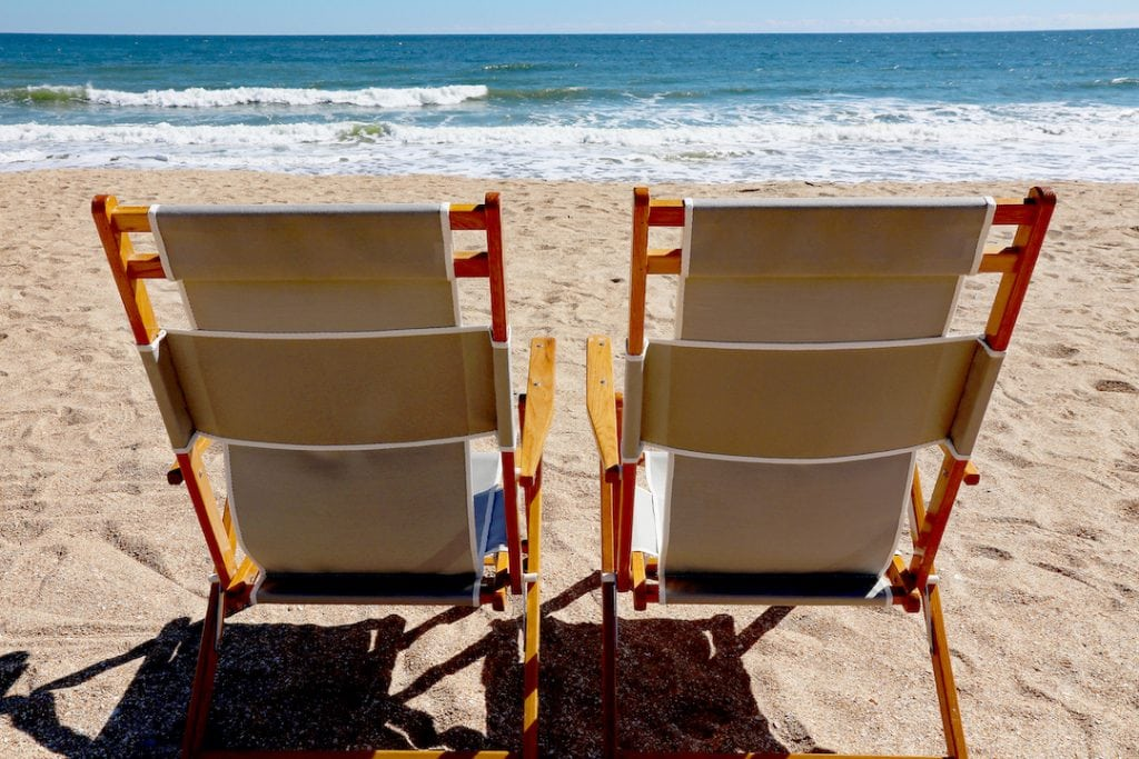 two beach chairs in sand facing ocean embassy suites st augustine
