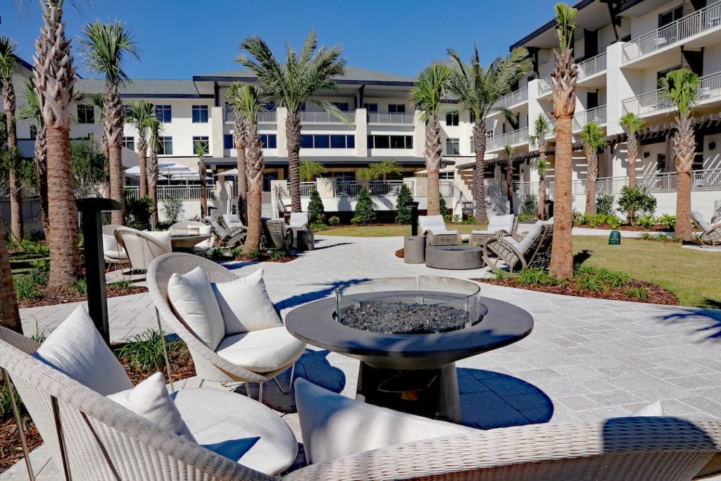 outdoor seating around metal firepit embassy suites st augustine beach oceanfront resort
