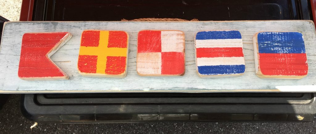 name made from nautical flags as letters