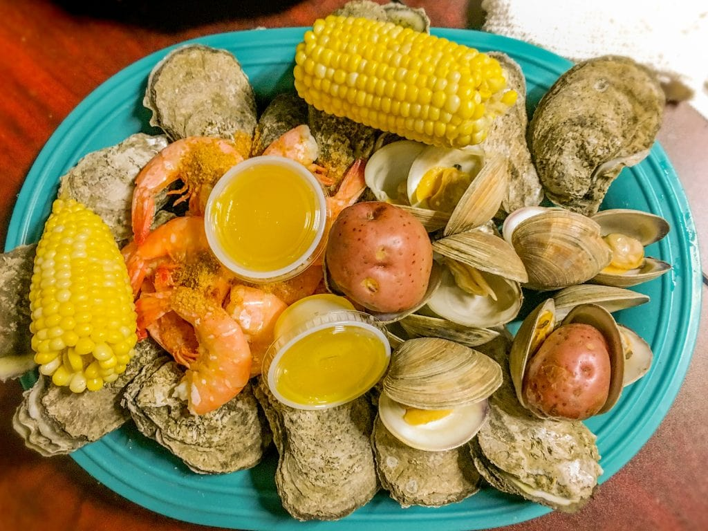 oysters potatoes corn on the cob melted butter on turquoise plate peace river seafood Punta Gorda fl