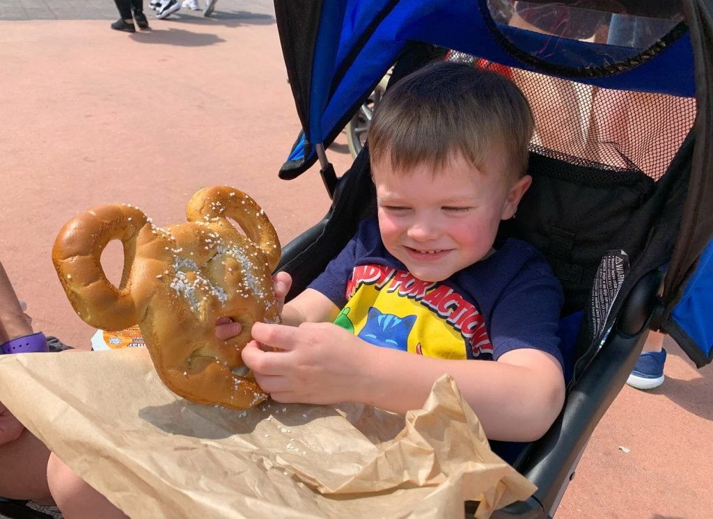 toddler with Mickey Mouse pretzel Walt Disney World