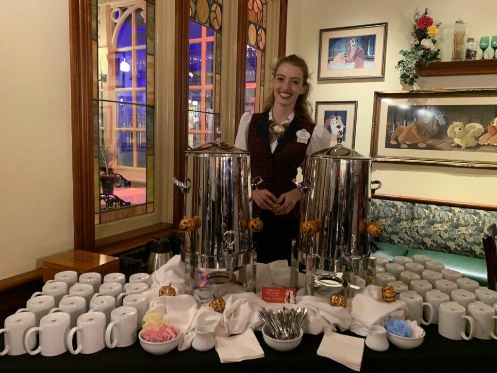 disney cast member serving coffee at cruellas halloween hideaway party