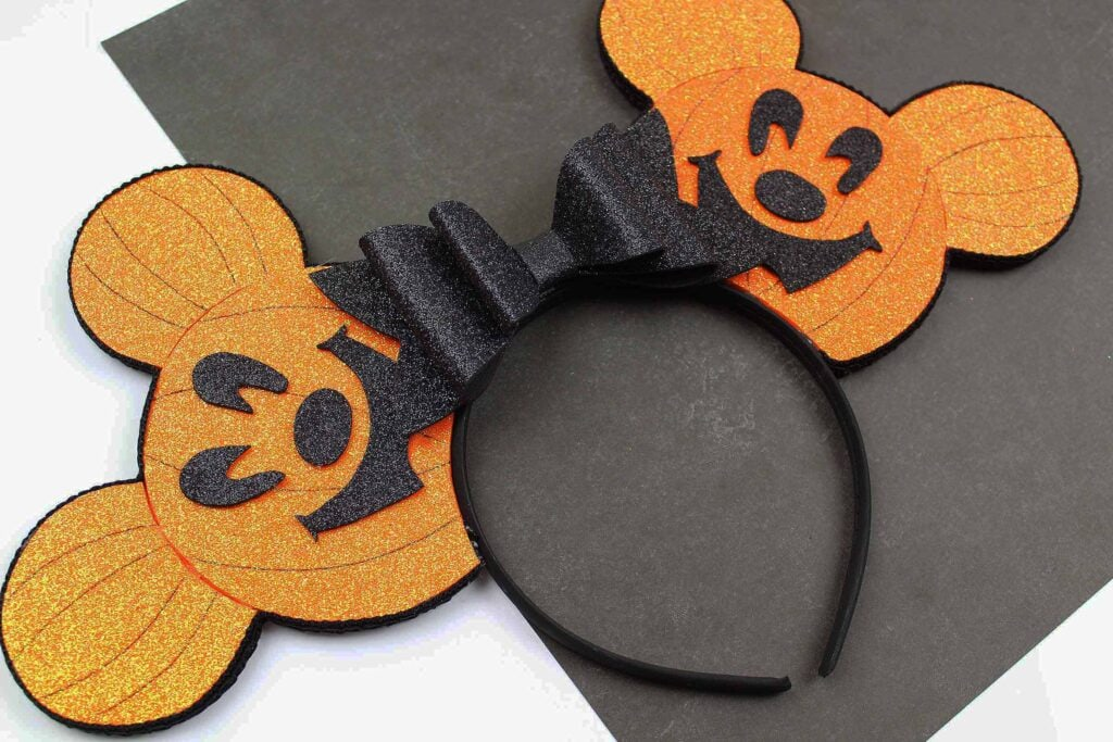 Halloween pumpkin Mickey Ears against black background