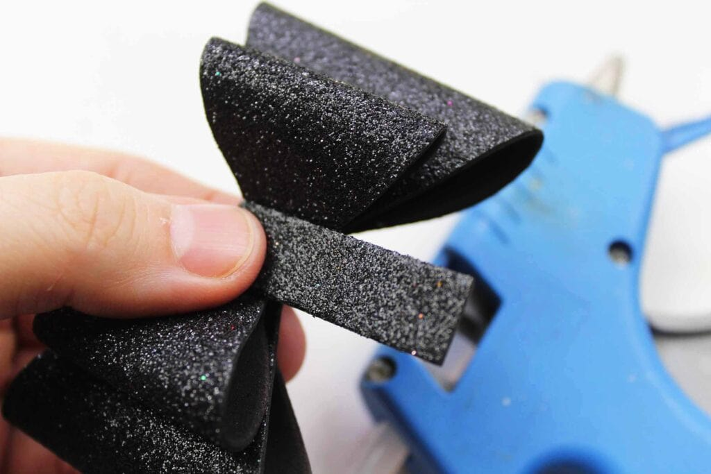 Making a Bow out of black glitter foam for Headband