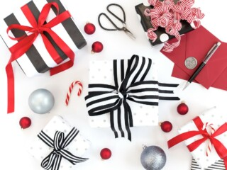 small gift boxes wrapped in black red and white gift wrap for inexpensive stocking stuffers