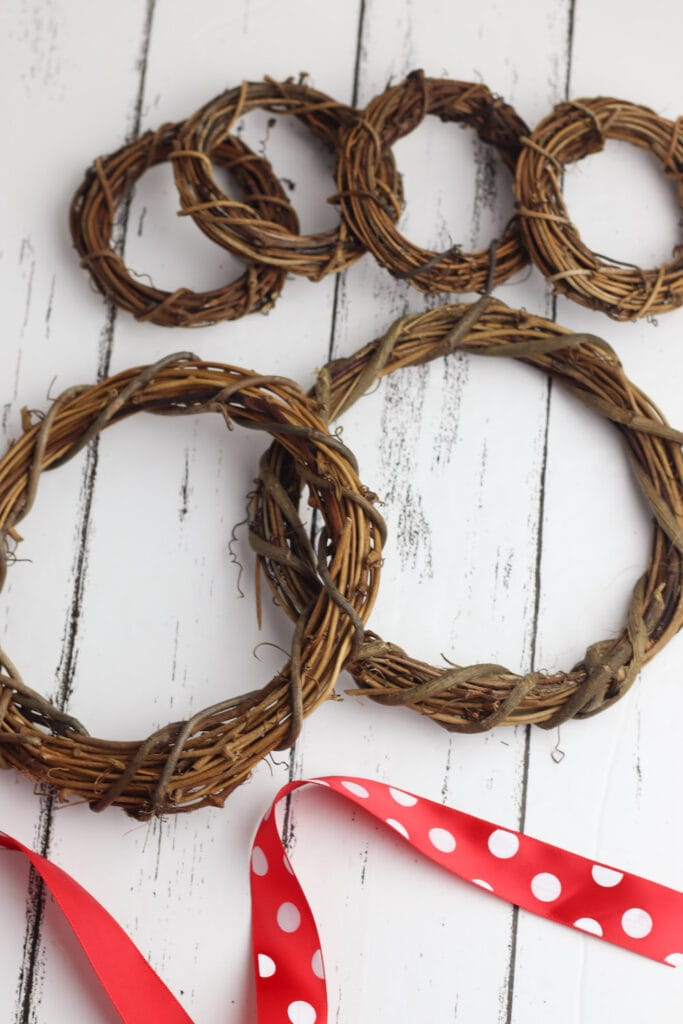grapevine wreaths on white wooden background