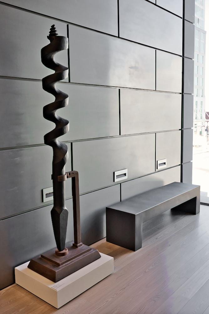 modern art metal sculpture against grey wall