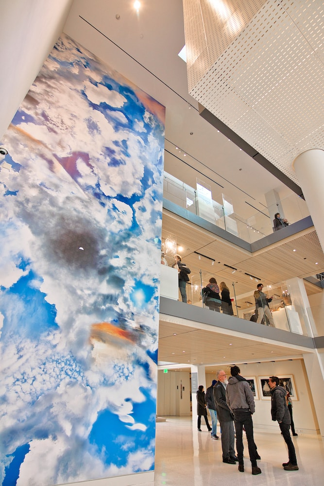 cloud mural on blue sky in lobby atrium