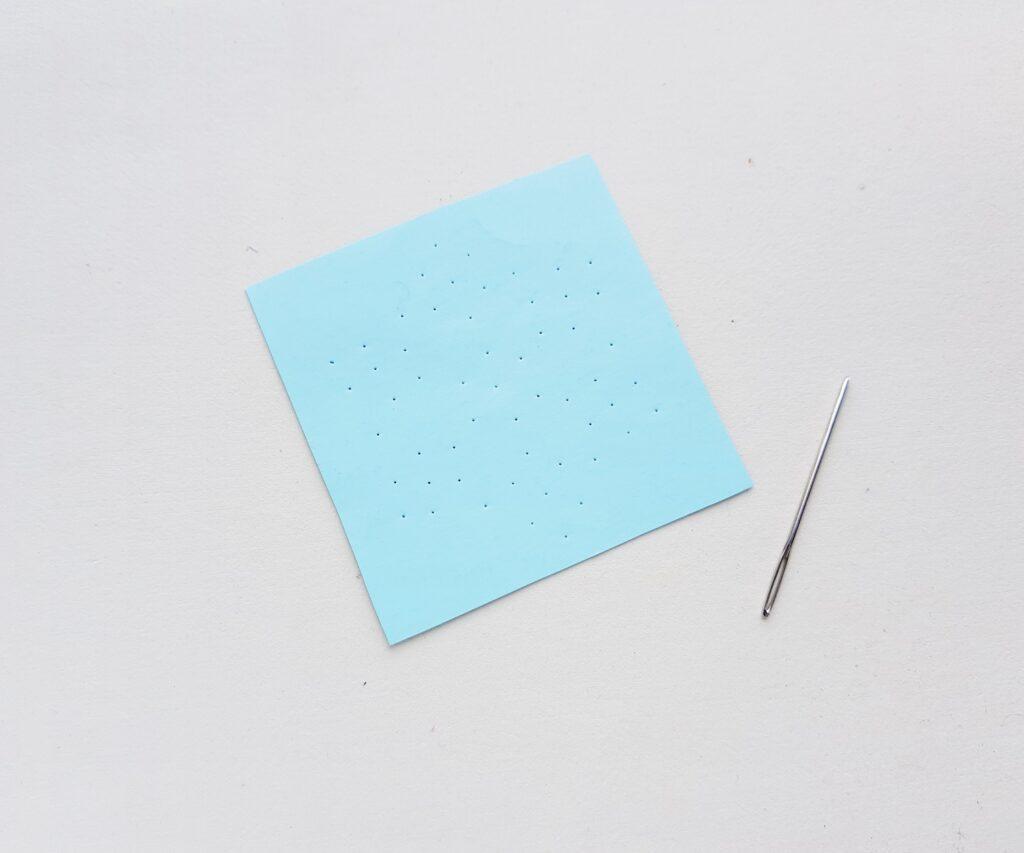 free string art pattern on blue cardstock