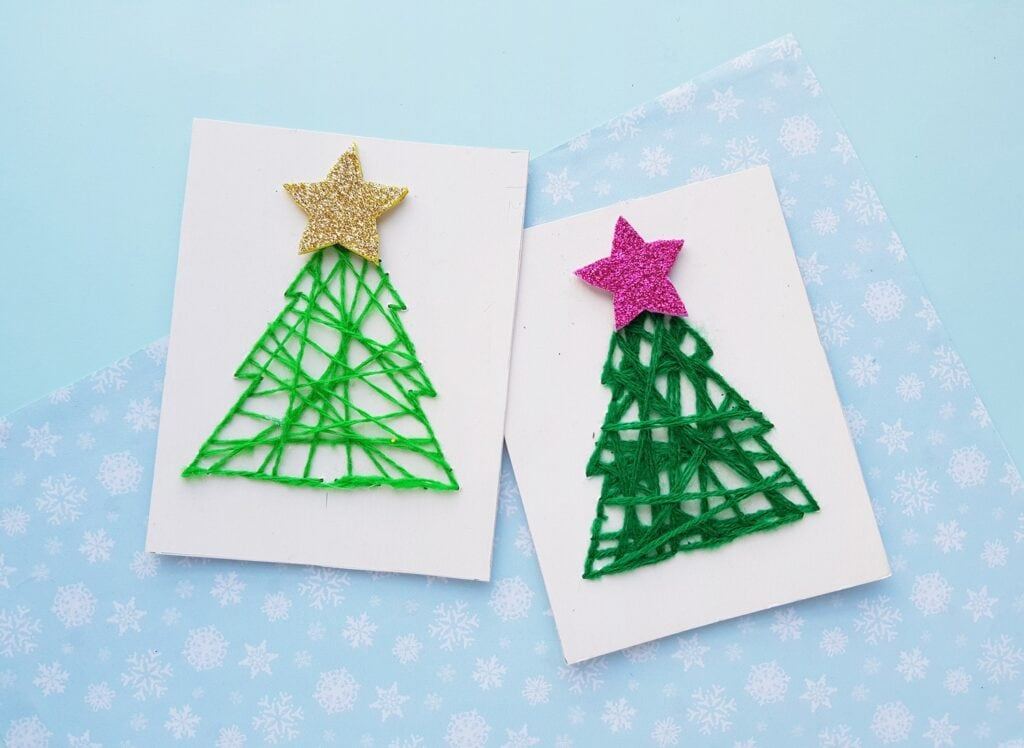 Christmas tree string art with green yarn on white card