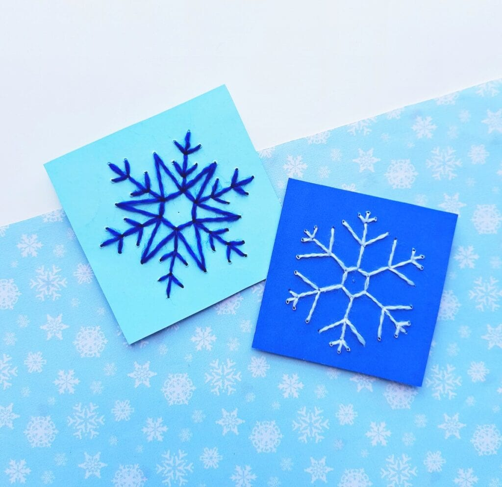 snowflake string art on blue cardstock