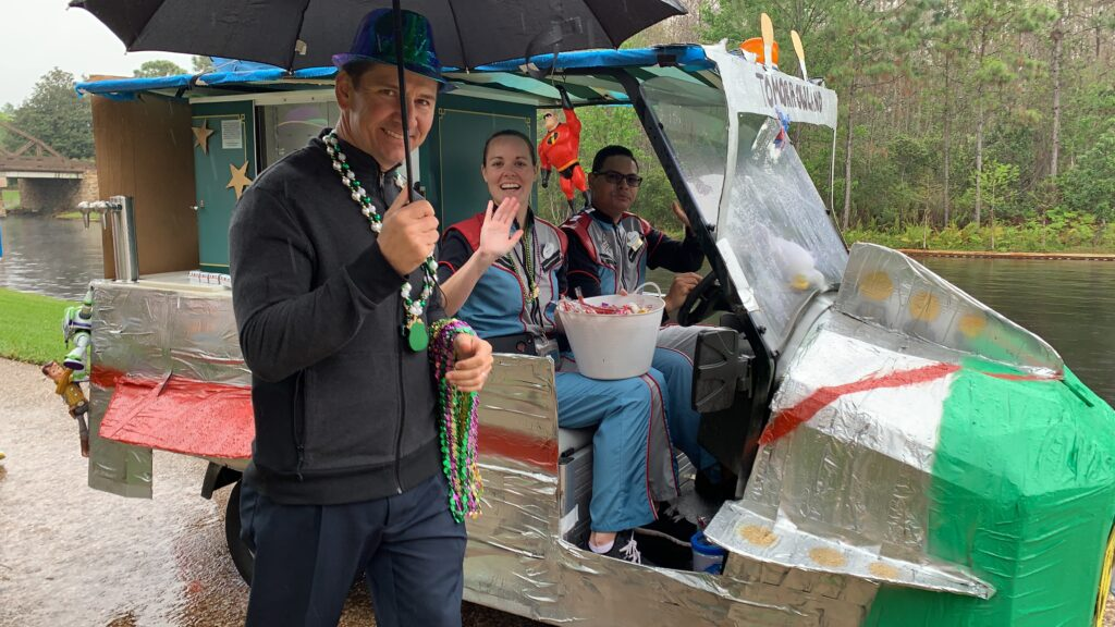 disney cast members throwing candy in Mardi Gras pargo parade