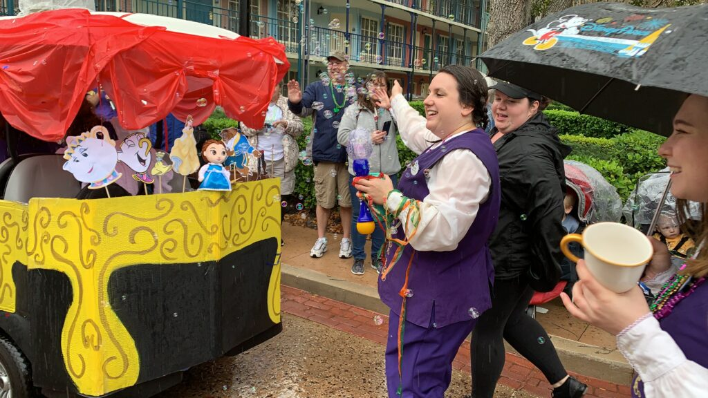 disney cast members blowing bubbles in Mardi Gras parade port Orleans resort
