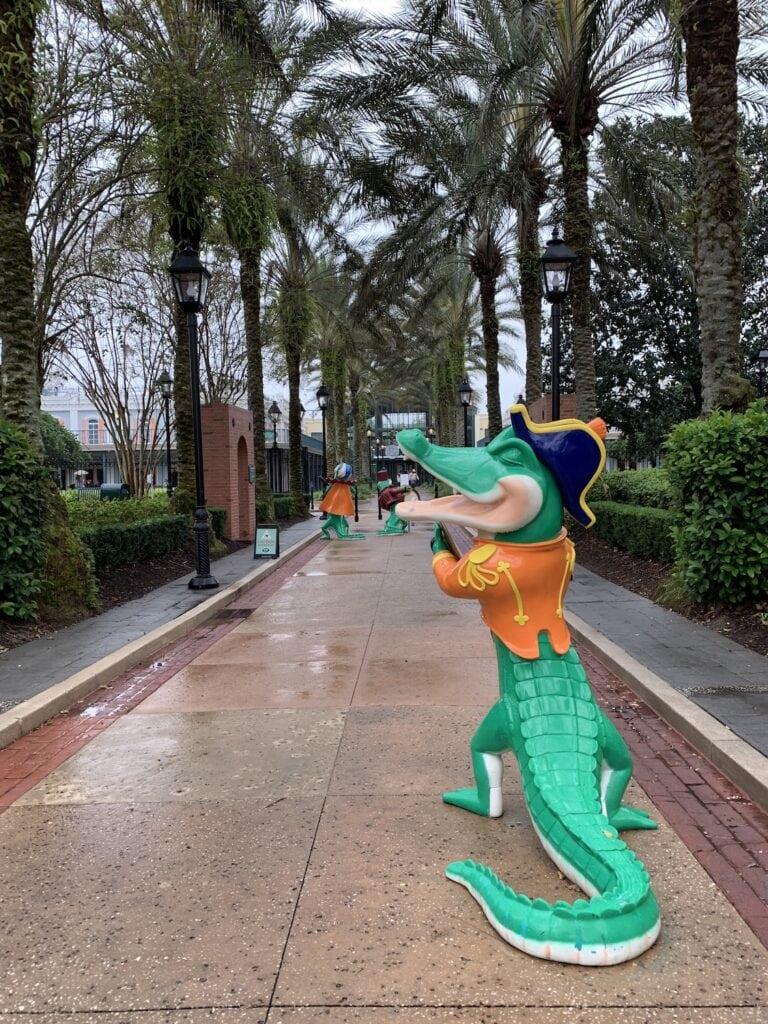 alligator statue in front of palm trees Disney Port Orleans Resort