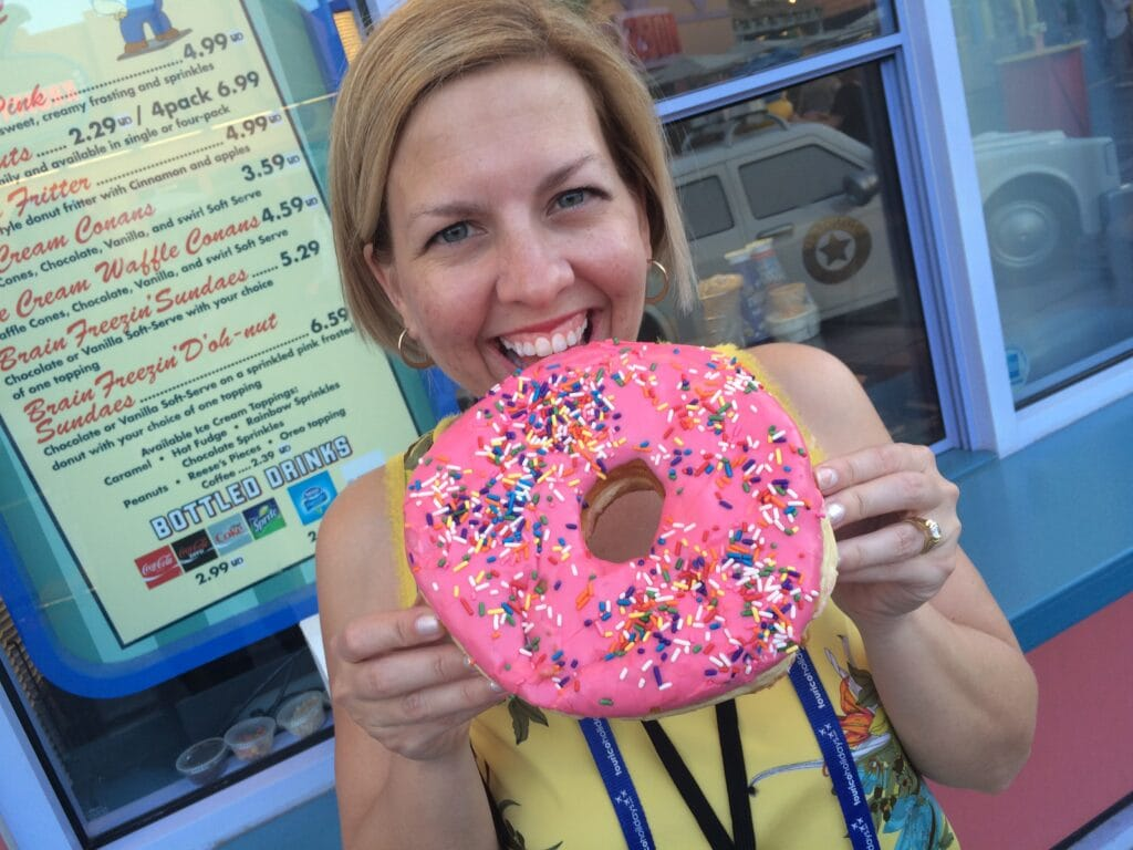 woman with huge pink iced donut at Universal Studios Orlando Resort