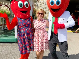 woman with strawberry mascot characters