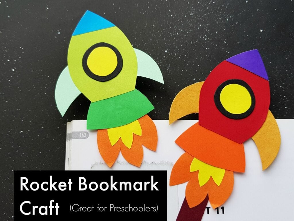 Paper rocket bookmarks laying on book