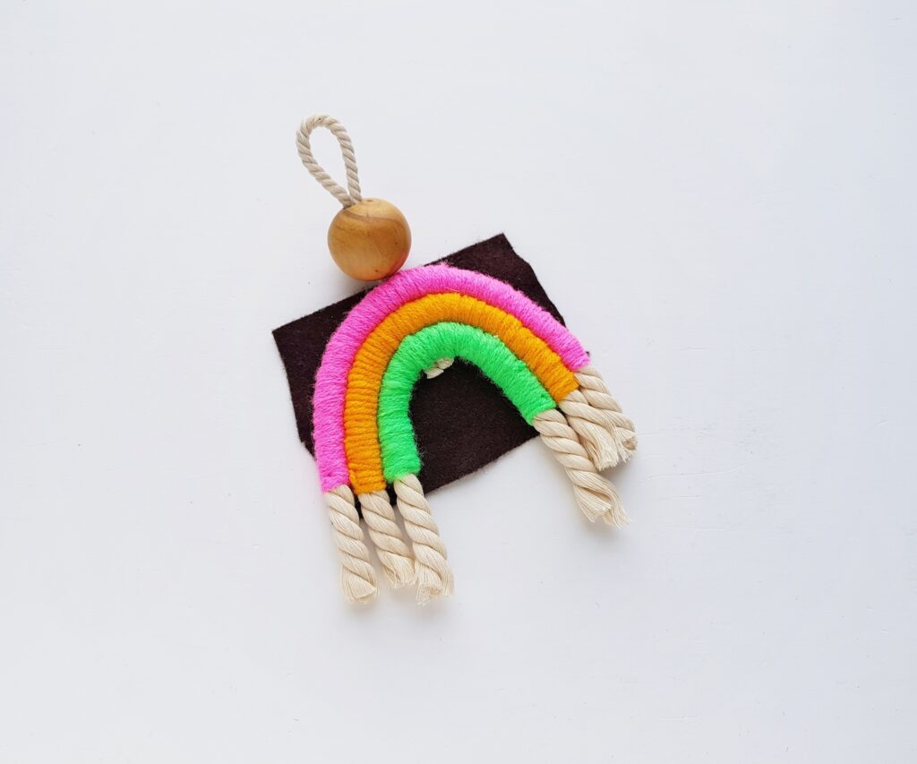 rainbow rope pieces glued to felt square