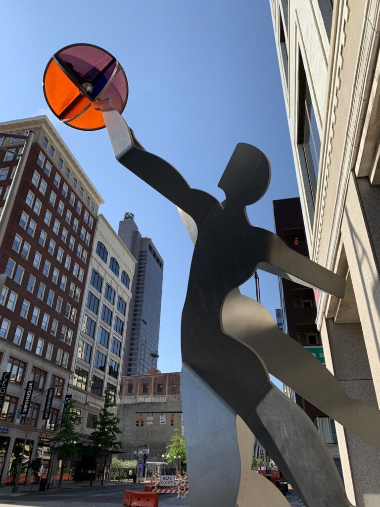 art sculpture against blue sky in downtown city