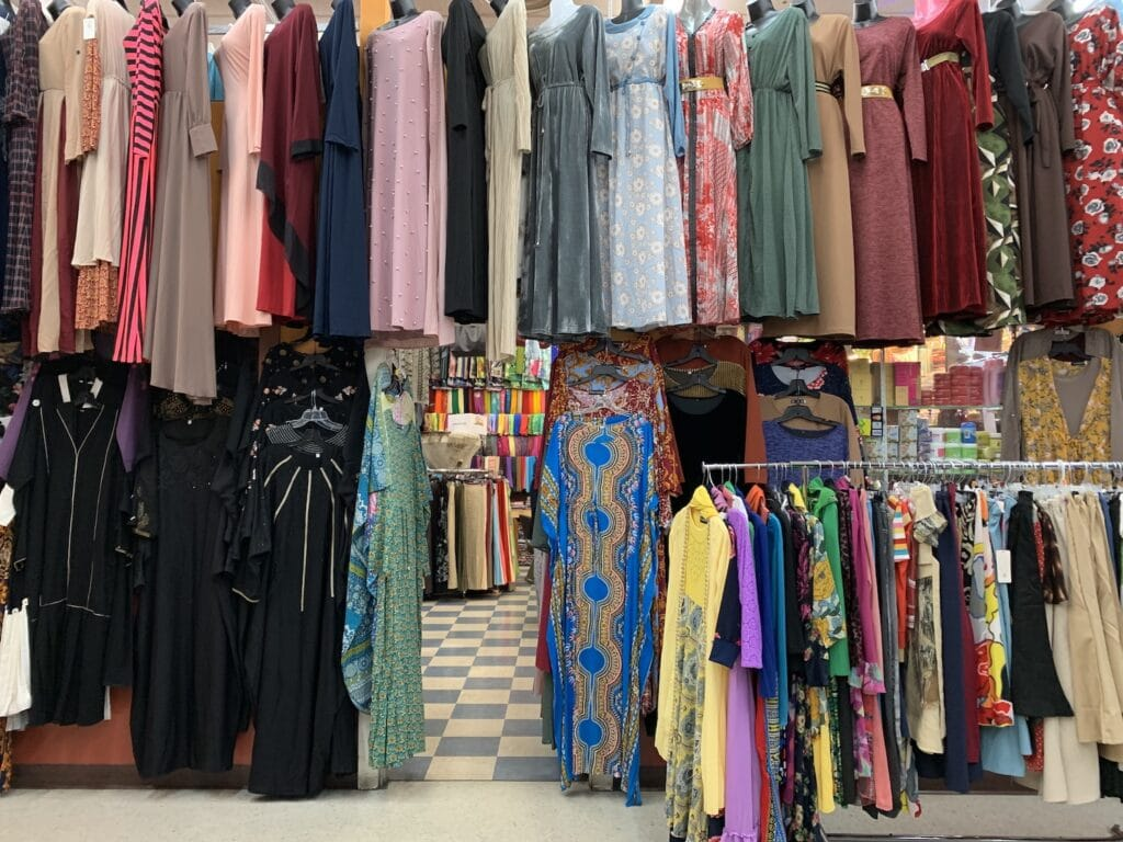 colorful clothing hanging in a market