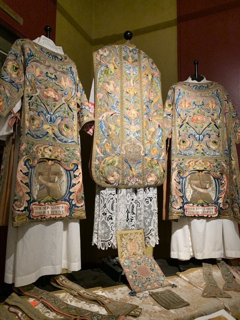three embroidered robes for religious services