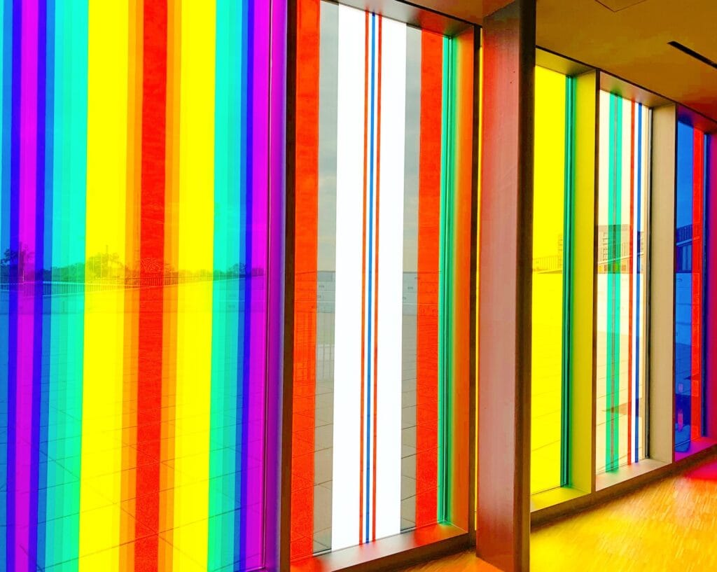 floor to ceiling windows with rainbow color stripes