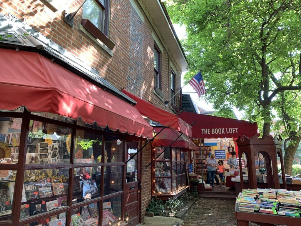 outside of a book shop with a big red awning