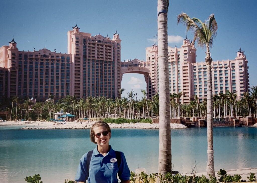 woman standing in front of Atlantis resort in Nassau Bahamas