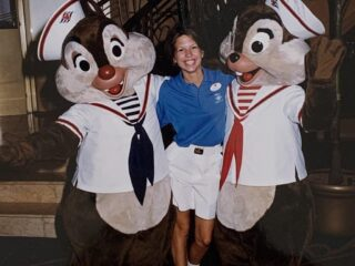 woman standing with Chip and Dale characters onboard cruise ship