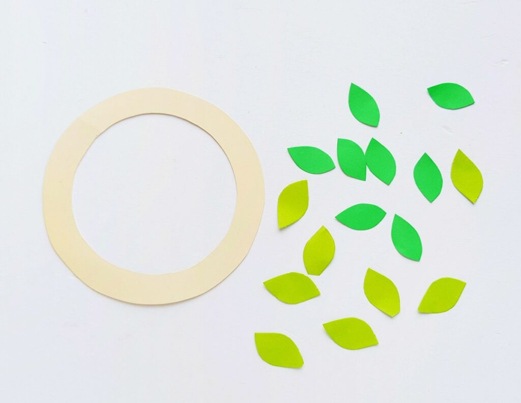 paper wreath circle with cut green paper leaves