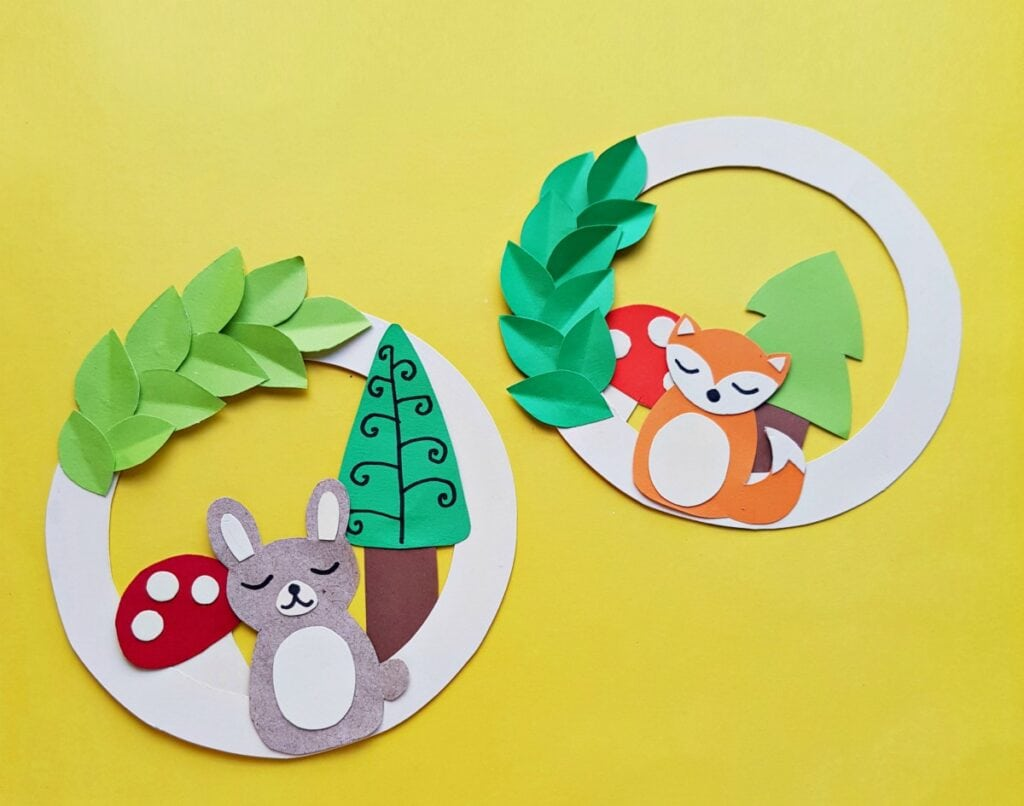 two paper wreaths with woodland animals