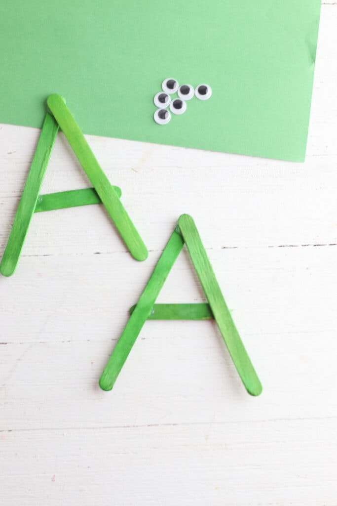 A shape made from green popsicle sticks