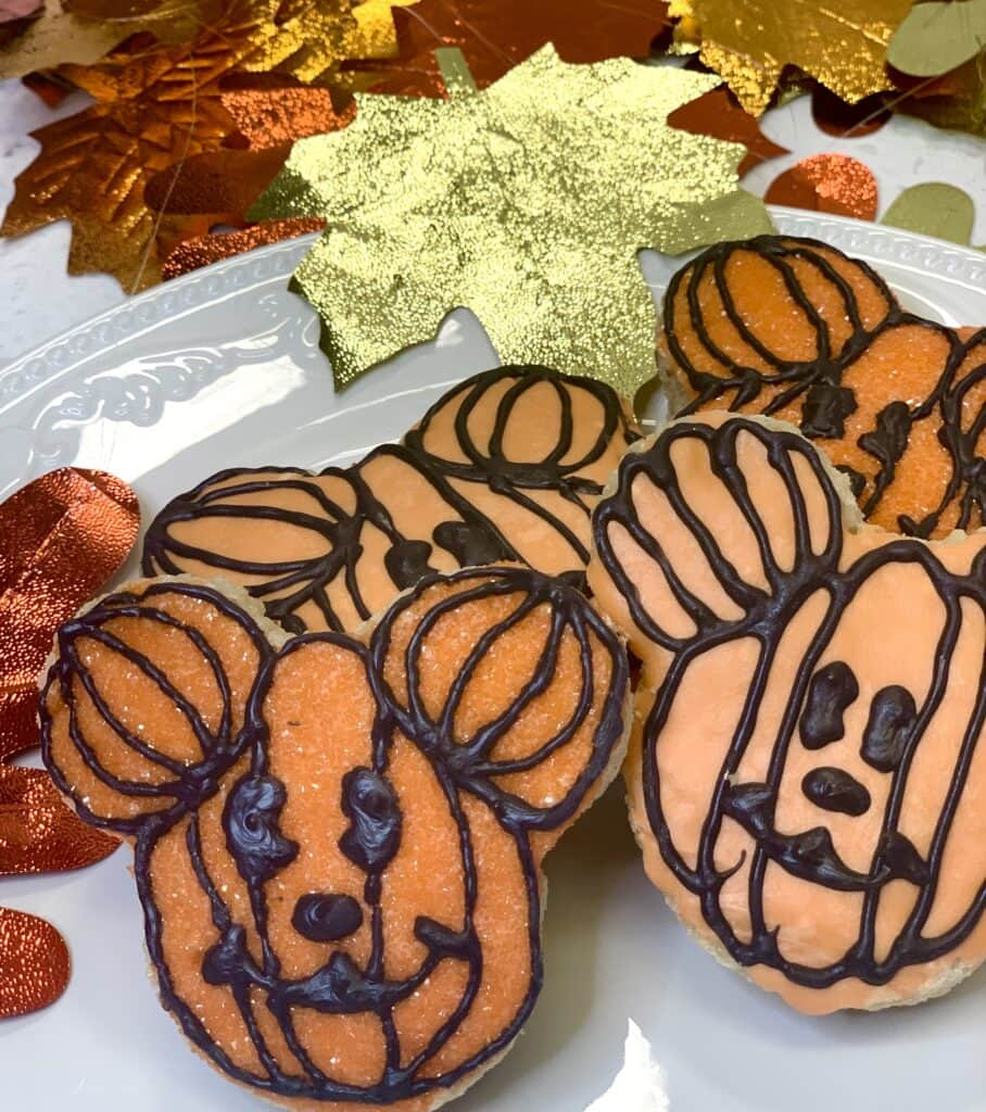 Mickey Mouse pumpkin snacks on a white tray