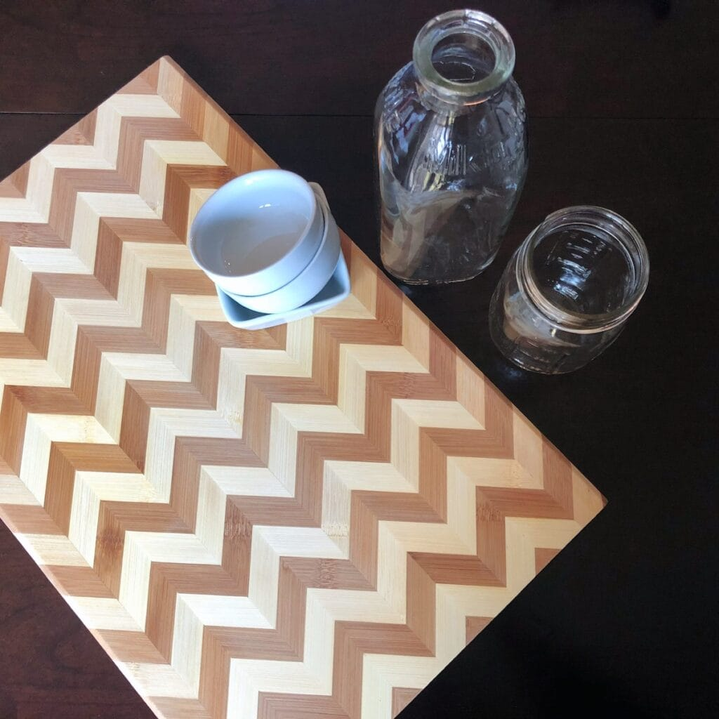 wooden cutting board and glass bowls