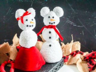two stuffed sock snow people in shape of Mickey and Minnie Mouse