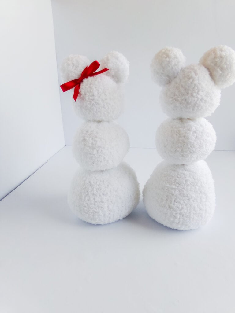 two white sock snow people with white background