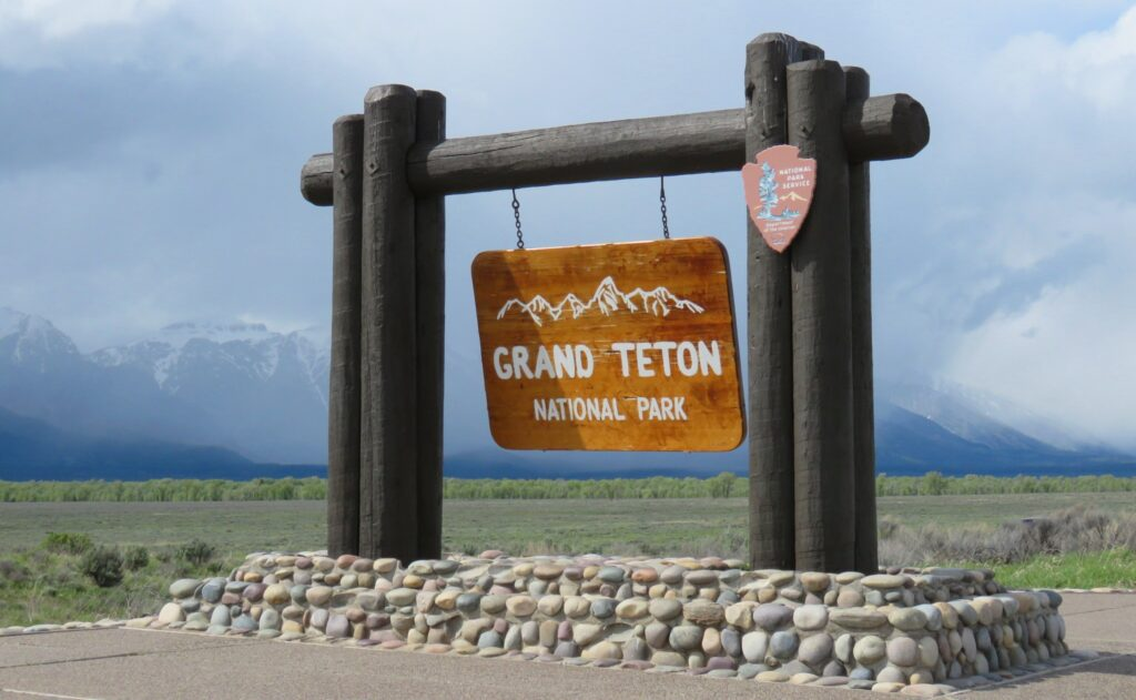 sign to the entrance of Grand Teton National Park
